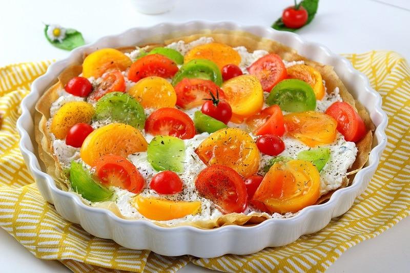Recette de tarte au tomates avec du fromage frais. Une recette parfaite pour l'été et facile à faire.